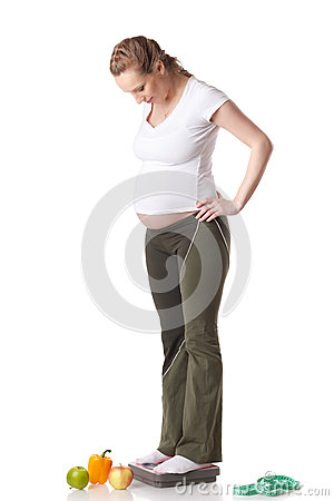 Young  pregnant woman with scales.