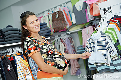 Young pregnant woman at shop