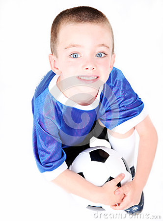 Young preschool boy with a soccer ball