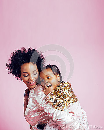 Free Young Pretty African-american Mother With Little Cute Daughter Hugging, Happy Smiling On Pink Background, Lifestyle Stock Images - 89341714