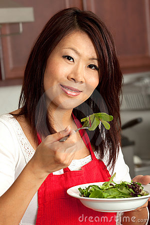 Young Pretty Asian Woman Preparing in Kitchen