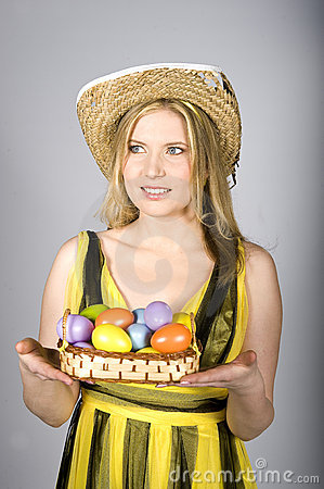 Young pretty easter woman with colourfull eggs