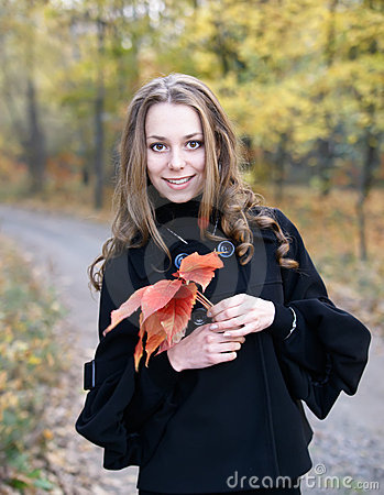 Young pretty girl in fall forest