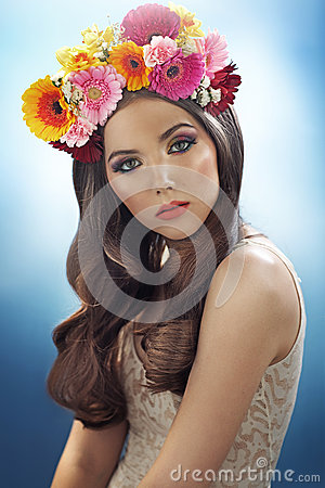 Young pretty girl with the flower hat