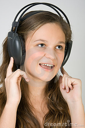 Young pretty girl listening music with headphones