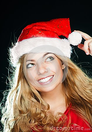 Young pretty girl in Santa hat