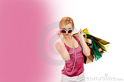 Young pretty shopping woman with lots of bags