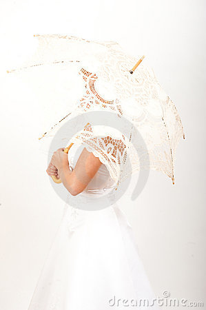 Young pretty woman bride with lace umbrella