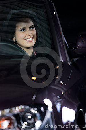 Young pretty woman driving car