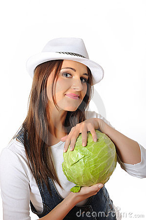 Young pretty woman with green cabbage
