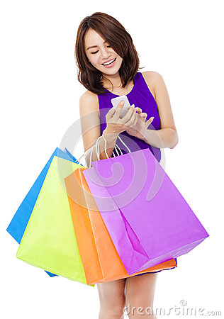 Free Young Pretty Woman Holding A Cell Phone To Shop Online Royalty Free Stock Photography - 45362307