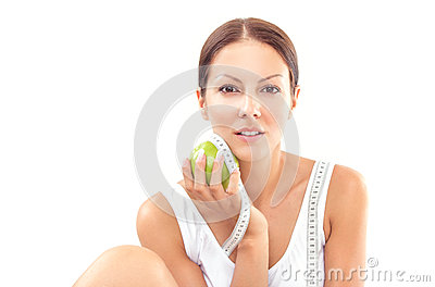 Young pretty woman holding apple