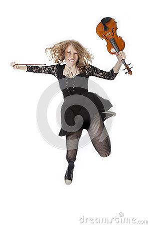 Young pretty woman jumping with violin