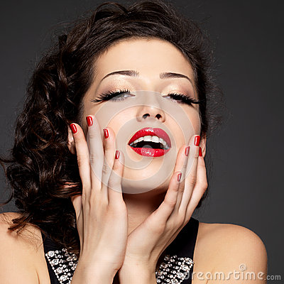 Young pretty woman with red nails  and  lips