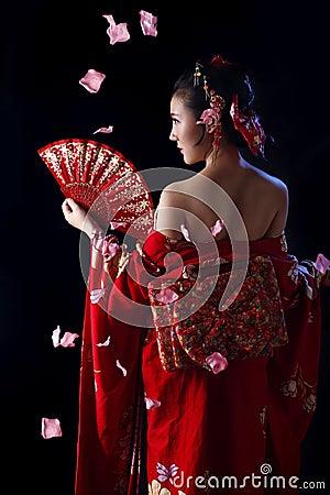 Free Young Pretty Woman Wearing Red Kimono Royalty Free Stock Photo - 67042215