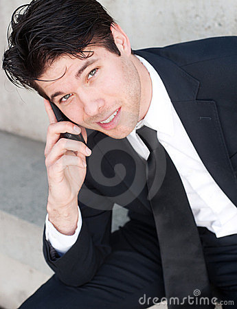 Young professional businessman on cell phone