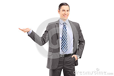 Young professional man in a suit gesturing with his hand