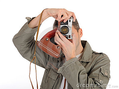 Young professional photographer with film camera