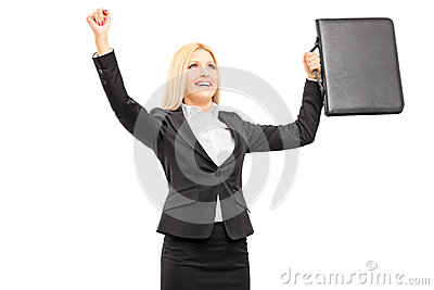 Young professional woman with briefcase gesturing happiness