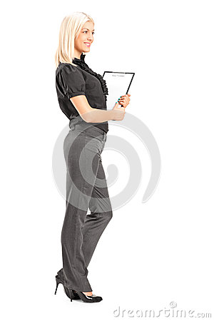 Young professional woman holding a clipboard