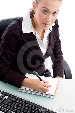 Young professional writing on notebook