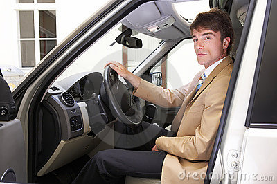 young proud executive test his new car on the road