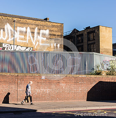 Free Young Punk Rock Guy Walking In Shoreditch. Royalty Free Stock Image - 54336656
