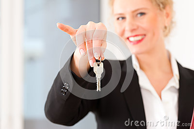 Young Realtor Is With Keys In An Apartment Stock Photography - Image: 24876312