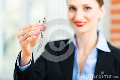 Young realtor is with keys in an apartment