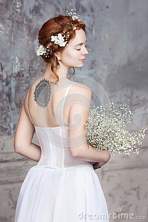 Free Young Red-haired Bride In Elegant Wedding Dress. She Stands With Her Back To The Viewer. Her Eyes Are Dreamy Closed. Royalty Free Stock Photos - 66796548