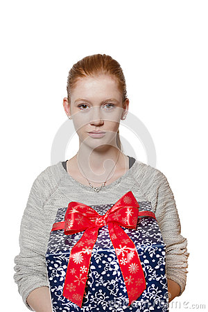 Young red haired Girl presenting a gift