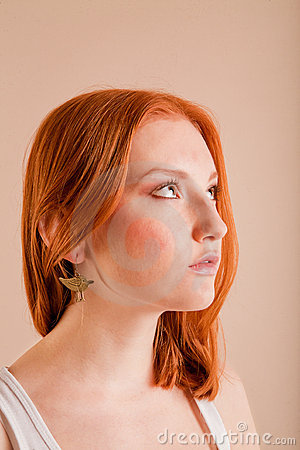 Young red-haired girl in profile