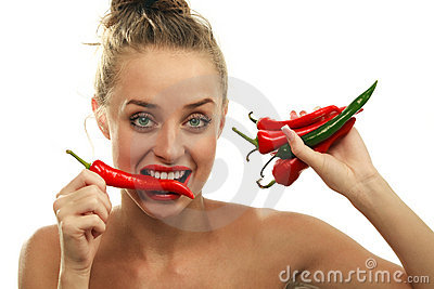 Young with red hot chilli pepper