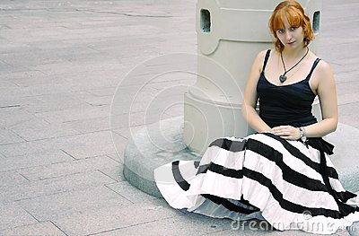 Young red woman in flared striped black and white