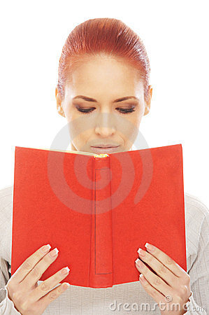 A young redhead Caucasian woman reading a book