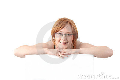 Young redhead woman with blank board