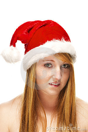 Young redhead woman wearing santas hat
