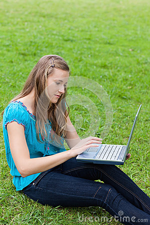 Young relaxed woman using her laptop