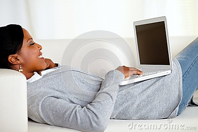 Young relaxed woman working on laptop