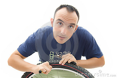 Young repairing bicycle wheel