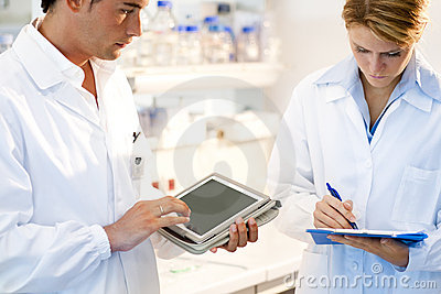 Young researcher using tablet PC