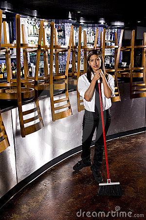 Young restaurant worker cleaning up