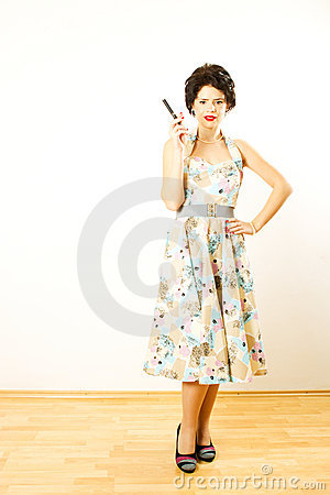 Young retro woman with electronic cigarette