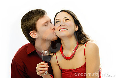 Young romantic couple drinking vine