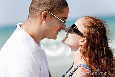 Young romantic couple about to kiss