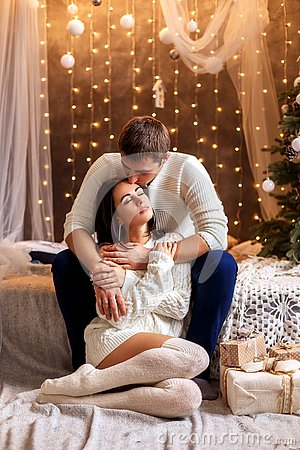 Free Young Romantic Couple Waiting For New Year And Christmas Holiday, Beautiful Bokeh Stock Photo - 133548990