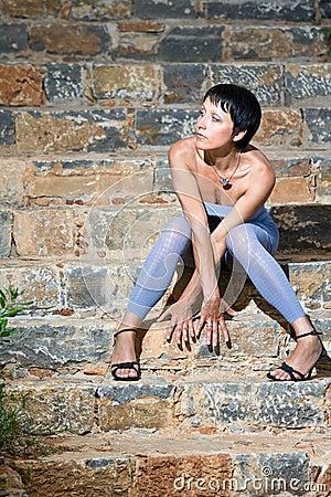 Young romantic beautiful woman sitting