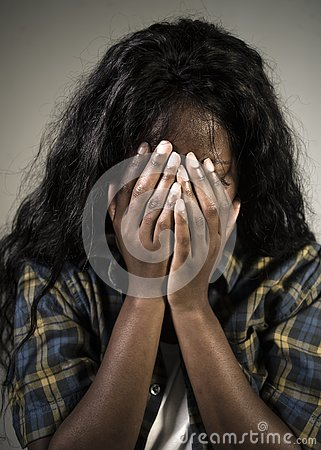 Free Young Sad And Depressed Black African American Woman Crying Anxious And Overwhelmed Feeling Sick And Stressed On Studio B Royalty Free Stock Image - 127611136