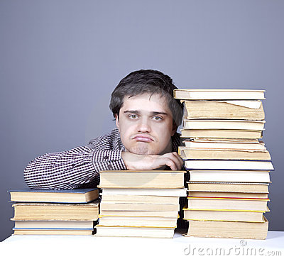 The young sad student with the books isolated.