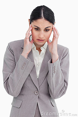 Young saleswoman experiencing a headache